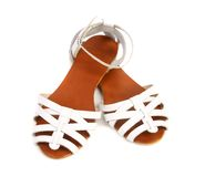 Pair of white leather female sandals Royalty Free Stock Image