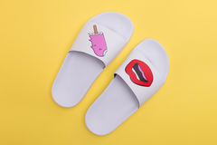 A pair of white rubber slippers stock photography