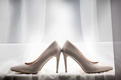 Pair of a white shoes, lying on the windowsill. royalty free stock photos