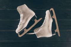 Pair of white skates on striped wooden surface. Top view of pair of white skates on striped wooden surface Stock Photos