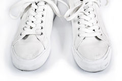 Pair of white sneakers with laces. On a white background Stock Image