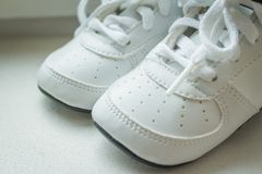 Pair of white sport sneaker shoes on white background.Baby sneakers, running shoes.Children shoes. Moccasins. Baby. Pair of white sport sneaker shoes on black royalty free stock photography