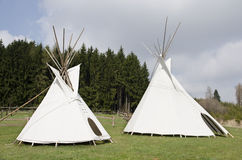 Pair of white teepee tents Stock Photos