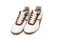 Pair of white trainers isolate Royalty Free Stock Photography