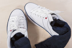Pair of White Trainers with Socks Inserted Inside Royalty Free Stock Photos