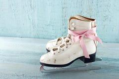 Pair of white women's ice skates Stock Photo
