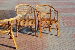 A pair of wicker chairs and table Stock Images