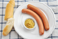 Wiener Sausage. Pair of wiener sausages with mustard Royalty Free Stock Photography