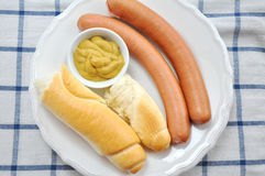 Wiener Sausage. Pair of wiener sausages with mustard Stock Photo