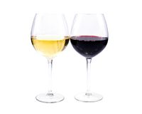 Pair of wine glasses. With red and white wine isolated over white background Stock Photography