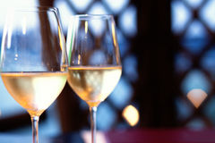 Pair of wine glasses in a fine dinning setting. Royalty Free Stock Photos