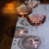 Pair of wine glasses on table Stock Images