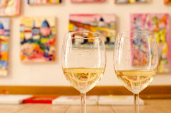 Pair of Wine glasses. Glasses of white wine in art gallery Royalty Free Stock Photography