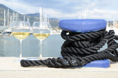 Pair of wineglasses against yachts Stock Images