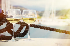 Pair of wineglasses against yachts Royalty Free Stock Photography