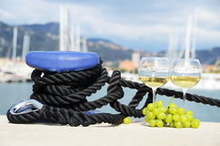 Pair of wineglasses against yachts Royalty Free Stock Image