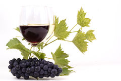 Pair of wineglasses and bunch of grapes. In white Stock Image