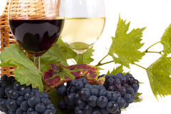 Pair of wineglasses and bunch of grapes Stock Image