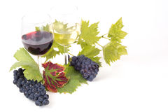 Pair of wineglasses and bunch of grapes. In white Royalty Free Stock Image