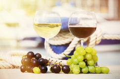 Pair of wineglasses and grapes Stock Photo