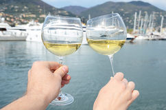 Pair of wineglasses in the hands Stock Image