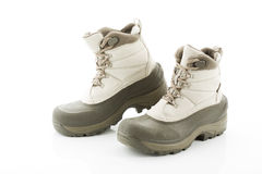 Pair of winter boots against white background Stock Photo