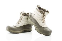 Pair of winter boots against white background Stock Photos