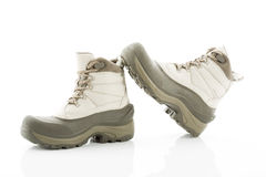 Pair of winter boots against white background Royalty Free Stock Image