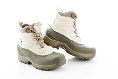 Pair of winter boots against white background Stock Images