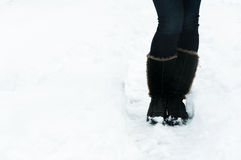 Pair of winter boots standing in snow Royalty Free Stock Photos