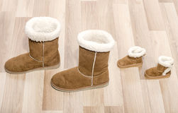Pair of winter woman boots and similar pair of kid boots. Stock Photography