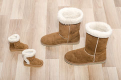 Pair of winter woman boots and similar pair of kid boots. royalty free stock images
