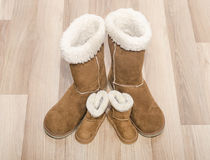 Pair of winter woman boots and similar pair of kid boots. Matching big and small boots stock image