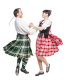 The pair woman and man dancing Scottish dance Stock Images