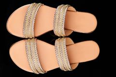 Pair of woman sandals. Above top view isolated on black background stock photography