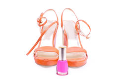 Pair of woman shoes with nail varnish Stock Photo