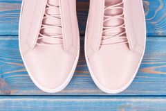 Womanly leather shoes on old blue boards. Pair of womanly leather shoes on old blue boards Stock Image