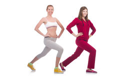Pair of women doing exercises Stock Images