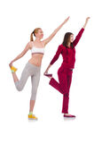 Pair of women doing exercises Royalty Free Stock Image