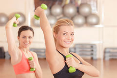 Pair of women doing weights fitness Royalty Free Stock Images