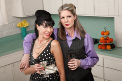 Pair of Women Enjoy A Drink Royalty Free Stock Photo