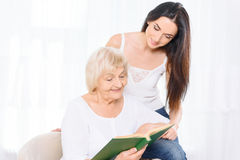 Pair of women reading book Royalty Free Stock Photo