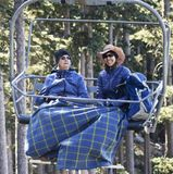 A Pair of Women Ride Arizona Snowbowl`s Scenic Chairlift Near Fl Stock Image