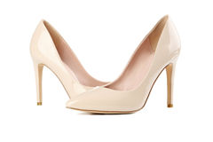 Pair of women's high-heeled shoes. Pair of beige women's high-heeled shoes  on a white Stock Image
