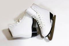 Pair of women`s white figure ice skates on white background Royalty Free Stock Image