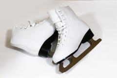 Pair of women`s white figure ice skates on white background Stock Images