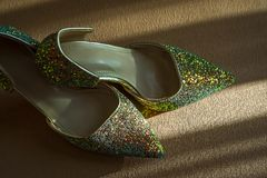 Pair of women shoes. With beautiful sequins stock images
