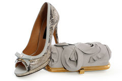 Pair of women shoes and handbag. Isolated over white stock photography