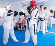 Pair of women in sparring  at taekwondo Stock Photo
