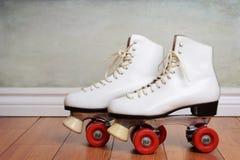 Pair women white quad roller skates Stock Photography